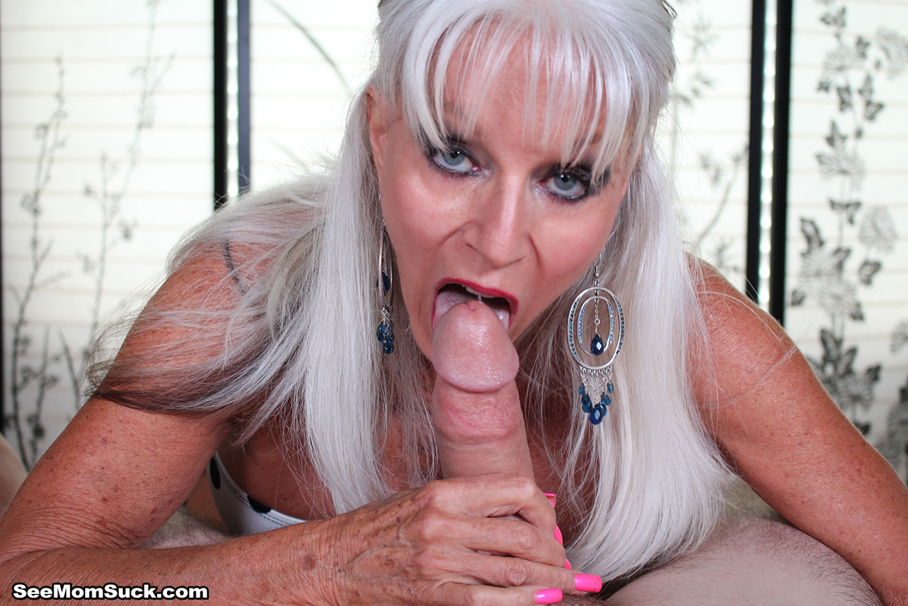 Hot cougar sucks dick while having a dildo in her cunt 2