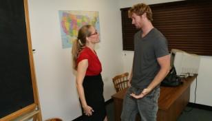 Mature teacher Sara James is scolding a student