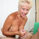Tracy Licks Cum Off a Younger Model's Cock