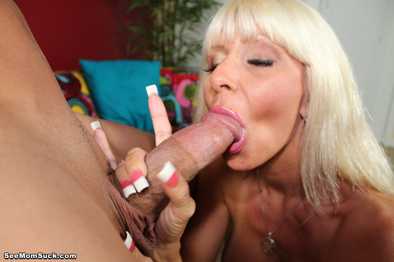The blonde goddess starts off by stroking the big cock until it gets really  hard, then she licks the head, slurping up all the pre-cum before suddenly  ...